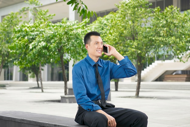 Young asian businessman talking on the phone