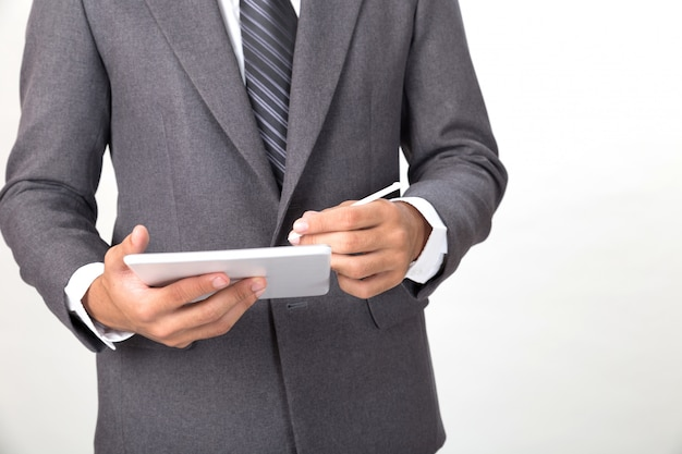 Young asian businessman wearing gray suit using  digital tablet