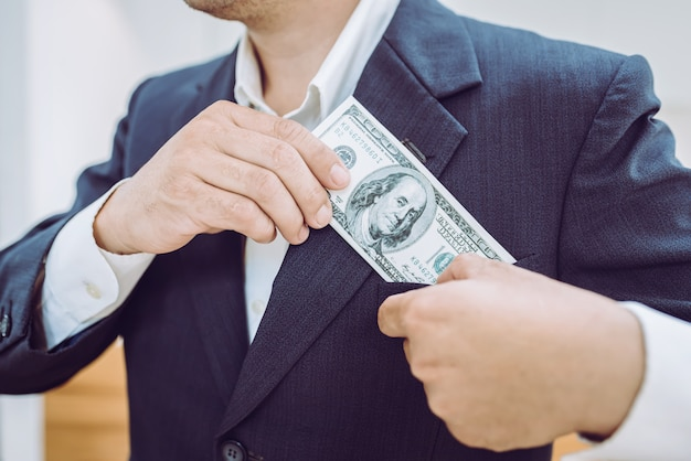 Young asian businessman with money bill and wallet.