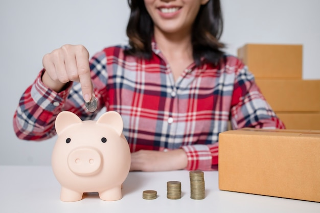A young asian businesswoman is saving money from online sales