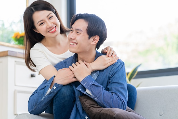 Young asian couple chatting happily