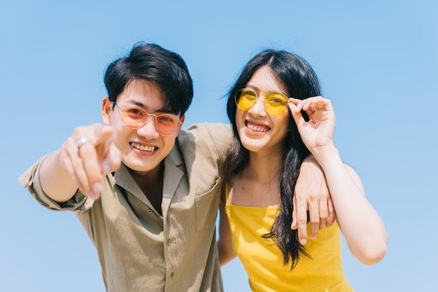 Young asian couple enjoying summer vacation on the beach