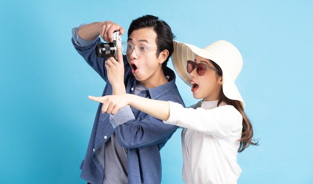 Young asian couple happily traveling together