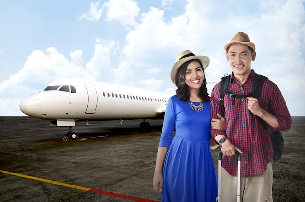 Young asian couple travel together with airplane