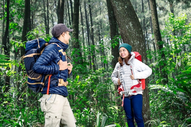 Young asian couple with backpack exploring