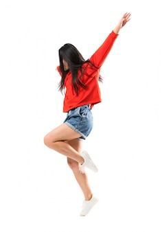 Young asian dancer over isolated white wall