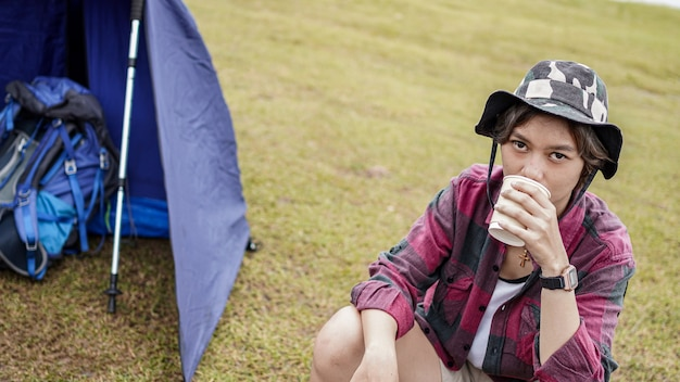 Young asian female drink coffee in chair