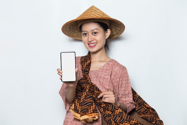 Young asian female farmer demonstrating mobile cell phone on white background