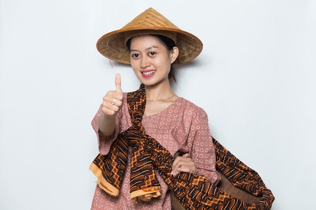 Young asian female farmer showing thumb on white background