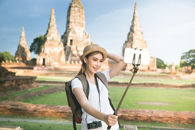 Young asian female traveler with backpack traveling ayutthaya province, thailand