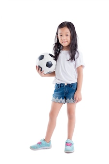Young asian girl holding ball and smiles over white background