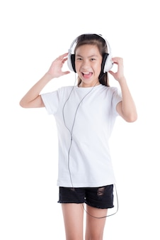 Young asian girl listening music from headphones