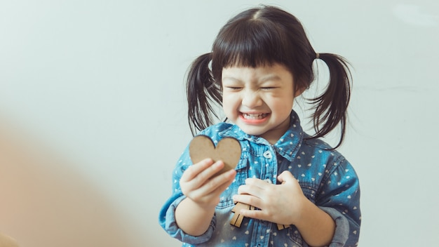 A young asian girl plays happily in the house.