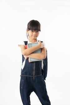 Young asian girl student holding book over head isolated on white background,  education and learning
