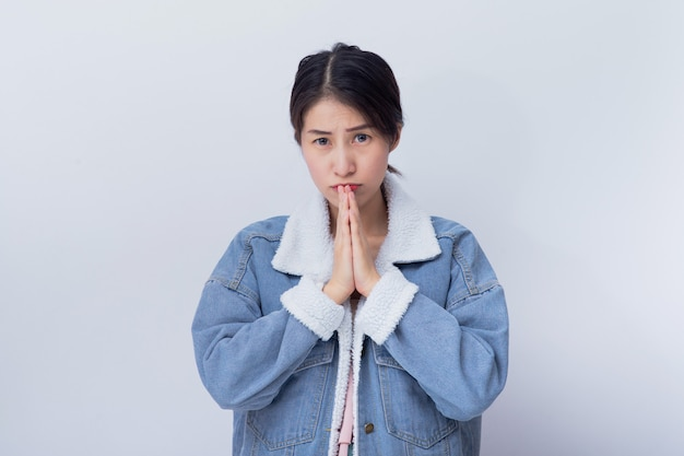 Young asian girl wearing blue casual clothes portrait in studio