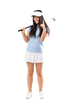 Young asian golfer girl over isolated white wall pointing up a great idea