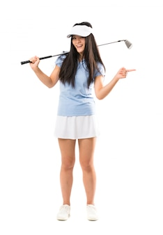 Young asian golfer girl surprised and pointing side
