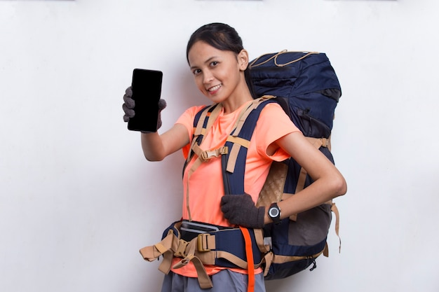 Young asian hiker woman showing mobile phone isolated on white background