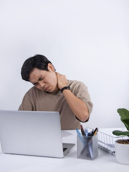 Young asian man feels bad in the office, he are suffering from work-related pain from office syndrome. studio shot isolated on white background.