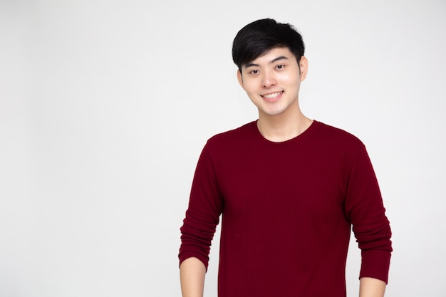 Young asian man smiling and looking at camera isolated on white background