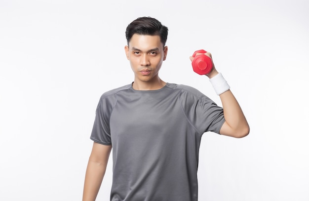 Young asian man in sport outfits exercising with dumbbells and looking to camera isolated