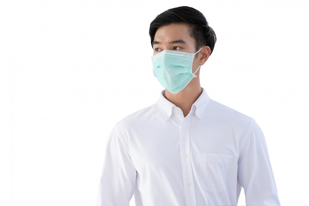 Young asian man wear medical face mask for protection coronavirus, covid-19 and pm2.5 isolated on white wall