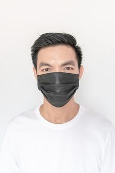 Young asian man wearing mask