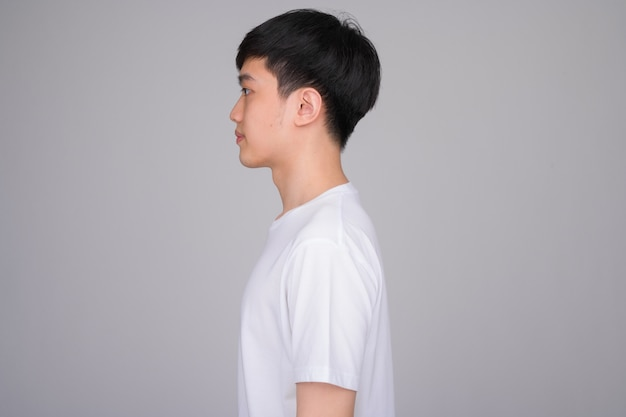 Young asian man on white