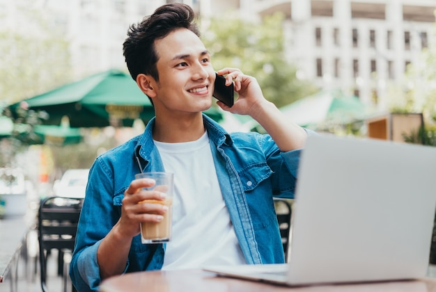 Young asian man working at coffee shop