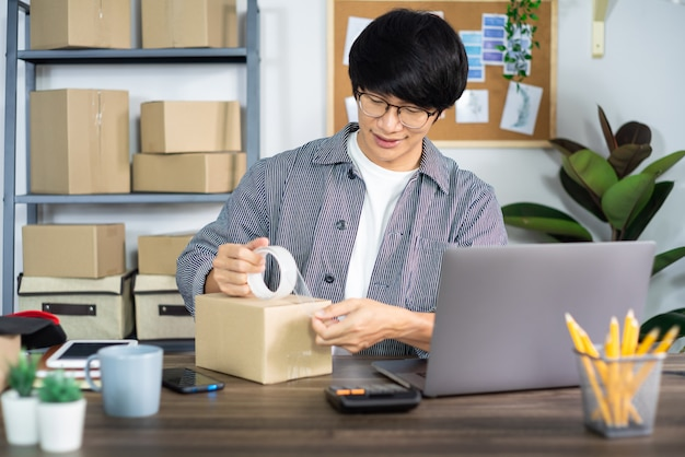 Young asian man working on delivery service office