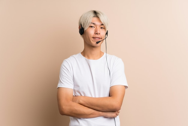 Young asian man  working with headset