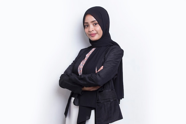 Young asian muslim business woman in head scarf smile with arms crossed on white background