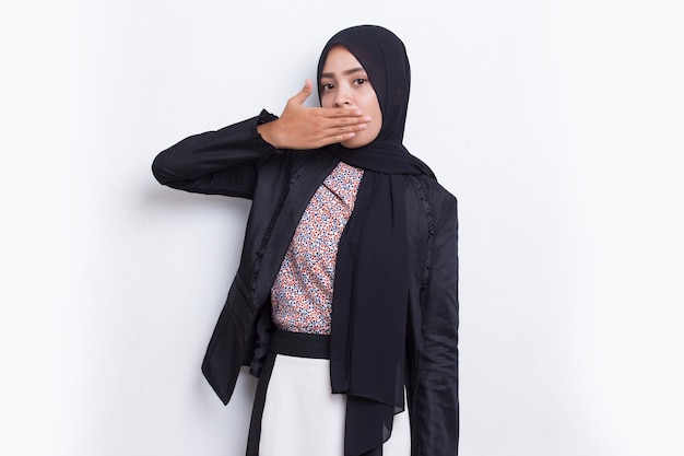 Young asian muslim business woman shocked covering mouth with hands for mistake secret