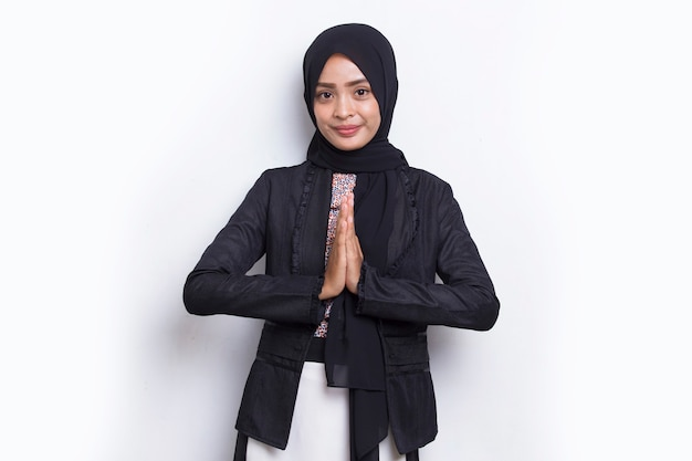 Young asian muslim business woman show welcome gesture isolated on white background