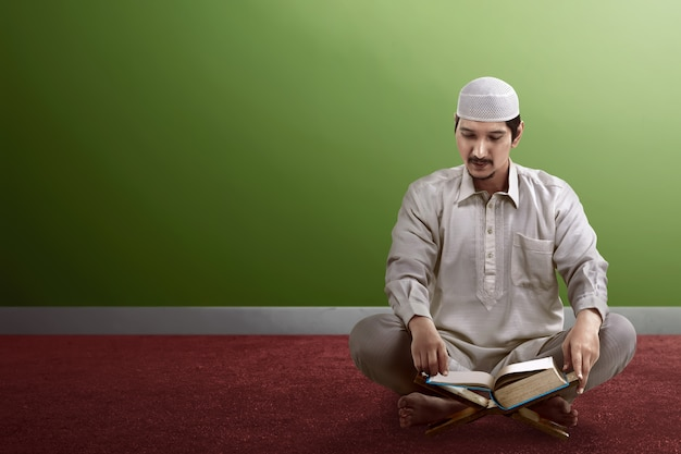 Young asian muslim people reading koran