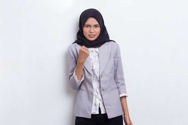 Young asian muslim woman angry emotional shouting and screaming on white background
