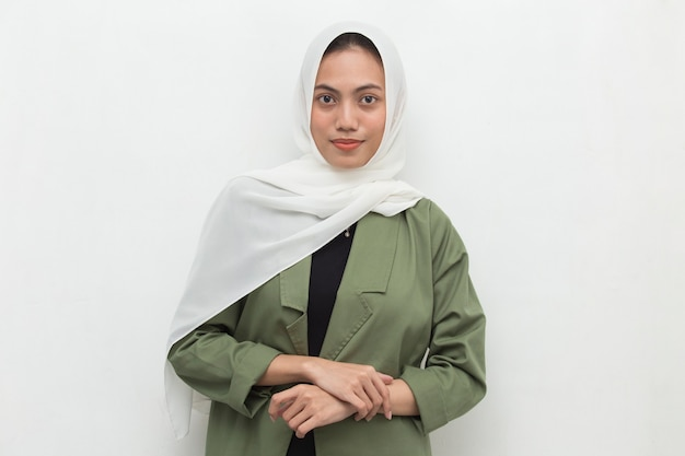 Young asian muslim woman in head scarf smile with arms crossed Premium Photo