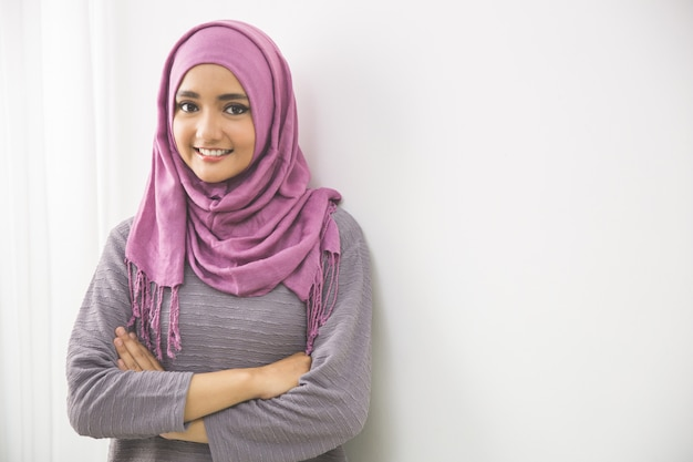 Young asian muslim woman in head scarf smiles
