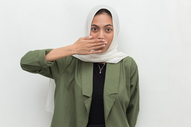 Young asian muslim woman shocked covering mouth with hands for mistake secret concept