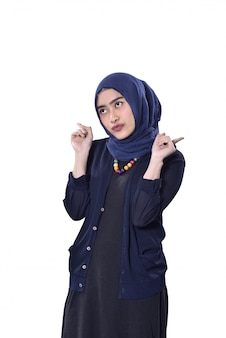 Young asian muslim woman with cute expression