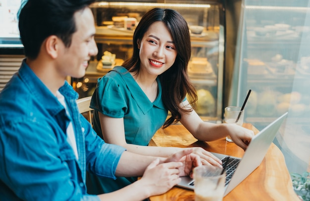 Young asian people working together at coffee shop
