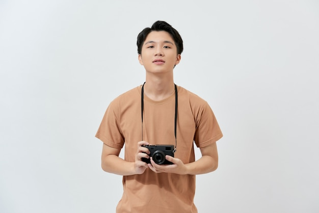 Young asian photographer in a brown t-shirt