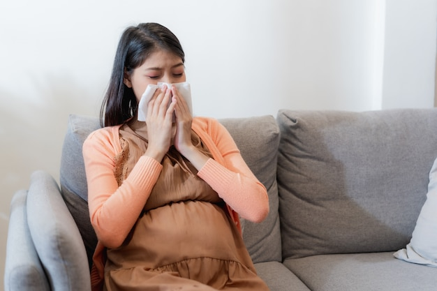 Young asian pregnant woman have suffering from flu and sneeze, runny nose, stuffy nose
