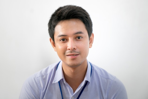 Young asian smiling businessman working in office and talking in video conference meeting.