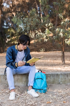 Young asian student reading book