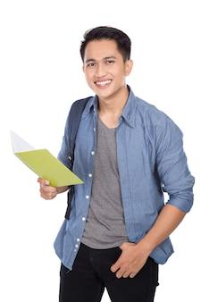 バックパックと本を保持している若いアジア学生