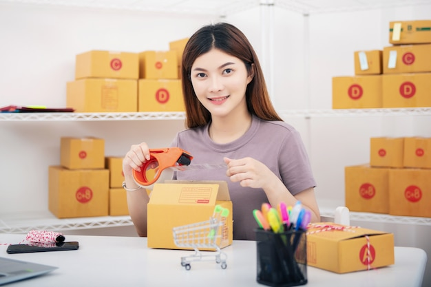 Young asian teenager owner business woman work at home for online shopping