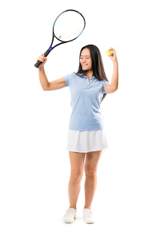 Young asian tennis player over isolated white wall