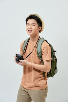 Young asian tourist in a brown t-shirt