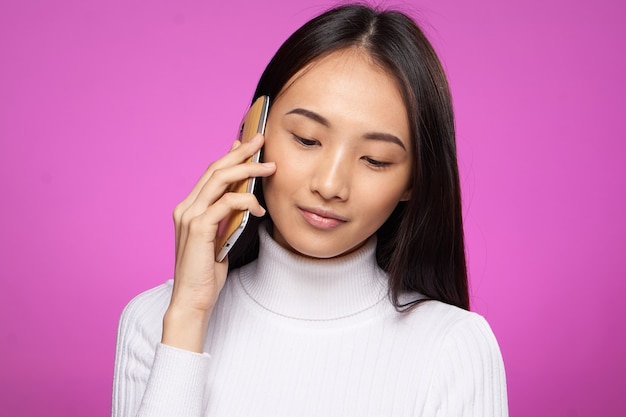 Young asian woman on a blue background posing, different emotions, mock up